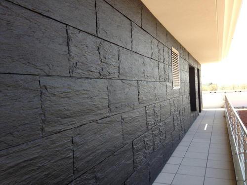 parement façade en béton imitation ardoise - La Manufacture des Bétons